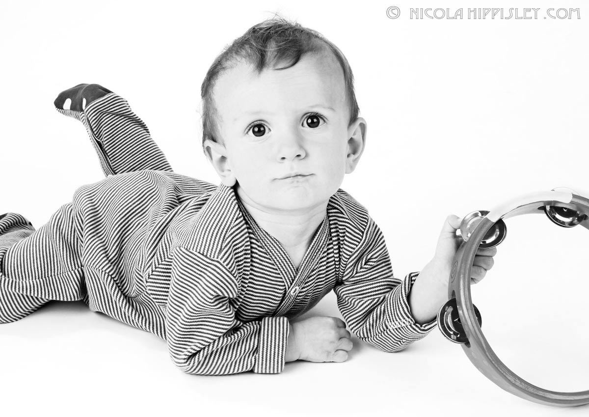 1baby_with_tamborine_portrait.jpg